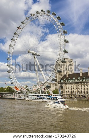 LONDON, UK - MAY 25, 2013: View of the London Eye. London Eye (135 m tall, diameter of 120 m) - a famous tourist attraction over river Thames in the capital city London.