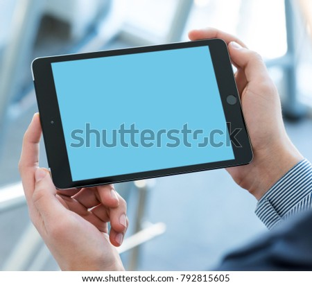 LONDON, UK, NOVEMBER 27, 2017 Businessman holding tablet pc device in hands. Clipping path included - Shutterstock ID 792815605