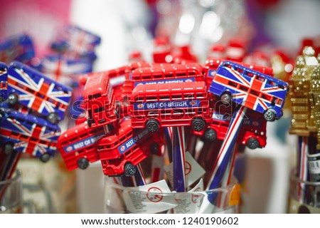 London, UK - 11 November, 2018 - Souvenir pencils decorated with double decker bus on display at Camden market  #1240190602