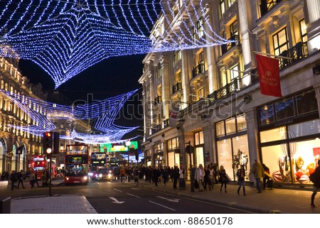LONDON, UK-NOVEMBER 10: The annual colourful Christmas lights are strung across London's famous Regents Street, to welcome and encourage shoppers to the street. November 10, 2011 in London UK.