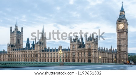 London, UK - Panoramic view of the Houses of Parliament, Palace of Westminster, Houses of Commons and Westminster Bridge. Big Ben tower with clock. No people, nobody. Early morning. Copy space