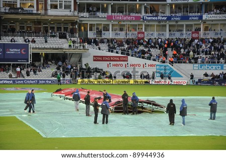 LONDON, UK - SEPTEMBER 9: Covers come on for rains at India vs England, 3rd ODI of India's 2011 tour of England, played at the Oval on September 9, 2011 in London, England.