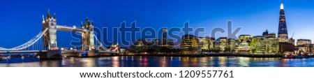 London, UK - September 2018: Night cityscape with Tower Bridge, the Shard and the city hall on Thames river banks #1209557761