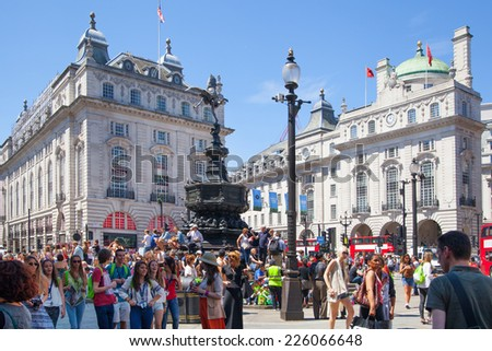 LONDON, UK - SEPTEMBER 30, 2014: People and traffic in Piccadilly Circus in London. Famous place for romantic dates.Square was built in 1819 to join of Regent Street
