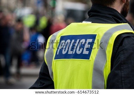 London, UK. 1st April 2017. EDITORIAL - Police officers watch over the English Defence League (EDL) Britain First rally with counter demo by the Unite Against Fascism (UAF) movement in central London.