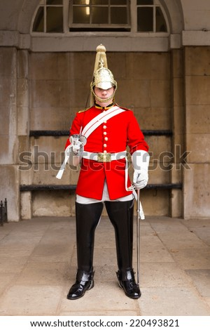 LONDON, UK - 26TH SEPTEMBER 2014: A Queens Guardsman standing to attention near Horse Guards Parade in London