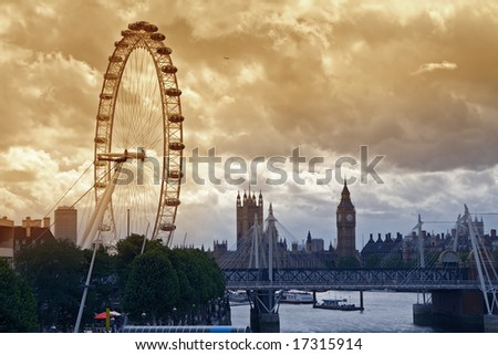 London under a moody sky. London Eye with view of Big Ben across the river Thames with sepia skyscape.