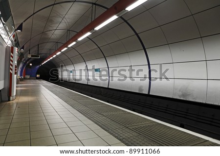 London underground train station with a view of the tunnel entrance.