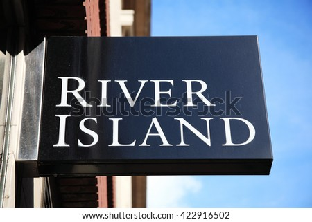 London, United Kingdom, April 11, 2012 : River Island clothing store logo advertising sign at their  Marble Arch retail outlet in Oxford Street