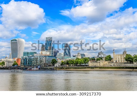 London, United Kingdom - August 22, 2015: City of London skyline, including the Tower of London and the skyscrapers 122 Leadenhall Street, Tower 42, 30 St Mary Axe and 20 Fenchurch Street.
