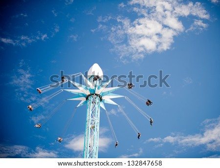 LONDON, UNITED KINGDOM - FEB 17, 2012: The Starflyer (Skyflyer) ride in Jubilee Gardens in front of the Shell Centre on the Southbank on February 17, 2012 in London, United Kingdom of Great Britain.