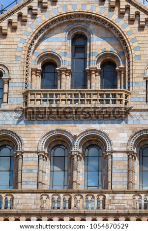 LONDON, UNITED KINGDOM - JUNE 23, 2017: Natural History Museum with ornate terracotta facade,  Victorian architecture, London, United Kingdom. Building built in the 19th century in style Victorian  #1054870529