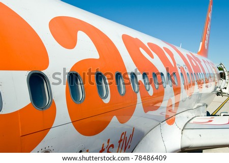 LONDON, UNITED KINGDOM - MAY 31: Boarding on Easy Jet airplane in Gatwick airport. Easy Jet is flying 48.8 million passengers with 125 airports in 29 countries. May 31, 2011 in London, United Kingdom.