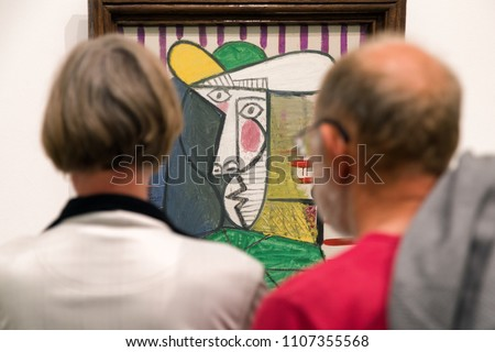 LONDON, UNITED KINGDOM - MAY 12: Visitors looking at Pablo Picasso painting Bust of woman at Tate modern on May 12, 2018 in London #1107355568