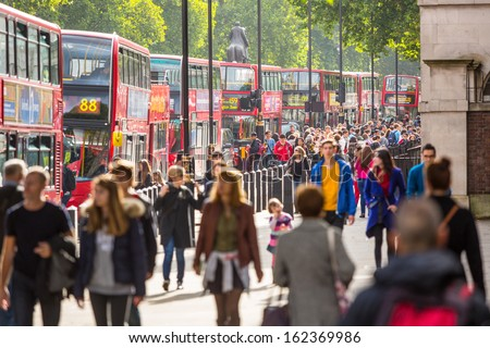 LONDON, UNITED KINGDOM - OCTOBER 25: Crowded Palace of Whitehall Street with many red double-decker buses  on October 25, 2013 in London, United Kingdom.