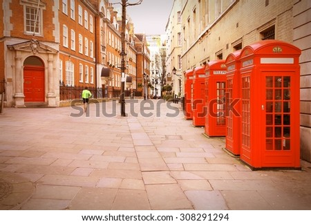 London, United Kingdom - red telephone boxes of Broad Court, Covent Garden. Retro photo filtered style.