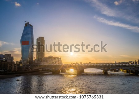 London, United Kingdom - Sunset at Blackfriars bridge and station with skyscraper at background