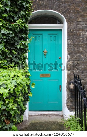 London, United Kingdom - typical colorful Victorian architecture door. - stock photo