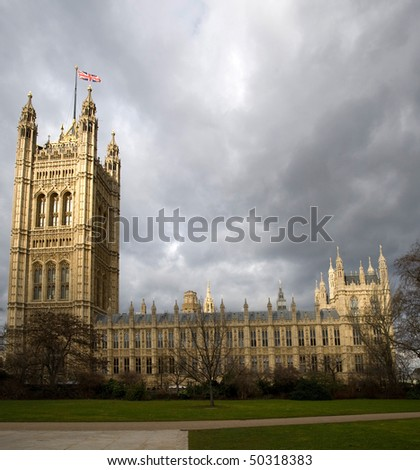 London. Westminster Abbey, houses of parliament with flag.