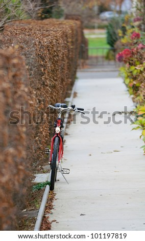 Lone bicycle parked in a small path.