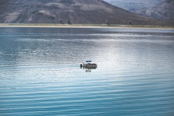 Lone boat floating in the Blue Mesa Reservoir