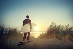 Lone Businessman by the Beach with Surfboard Concept
