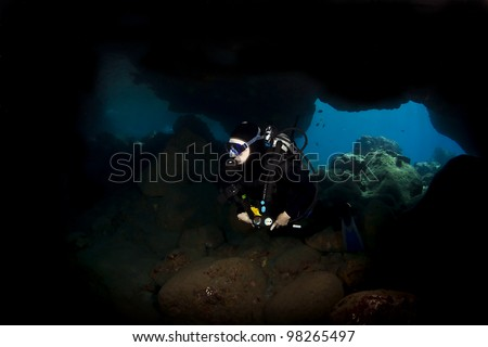 Lone Diver exploring a Lava Tube in Kona Hawaii