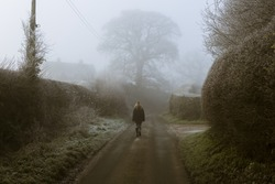 Lone Figure on country road (muted colours) Staffordshire UK
