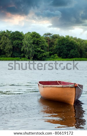 Lone fishing boat floating on the lake
