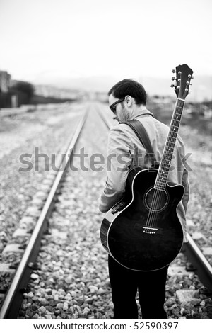 Lone handsome male musician on his way