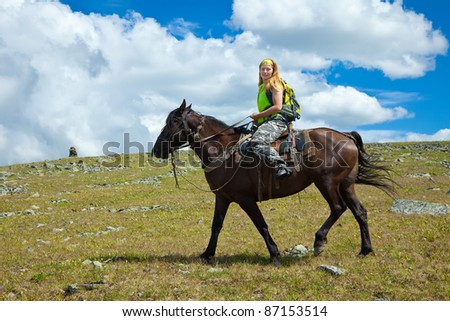 lone rider on horseback at mountains