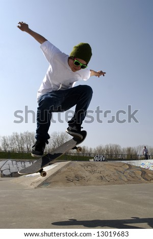 Lone skateboarder doing an ollie