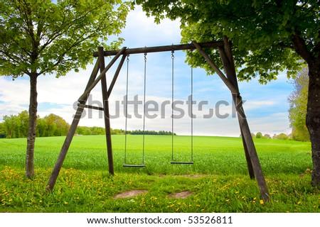 Lone swing seat in a summer field