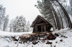 Lone wood cabin abandoned. Winter scene. Concept of lonesome, abandoned , cold heated feeling. Wide angle