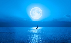 Lone yacht with Super Full Moon