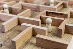 loneliness concept, wooden maze template with lonely person, problem resolve