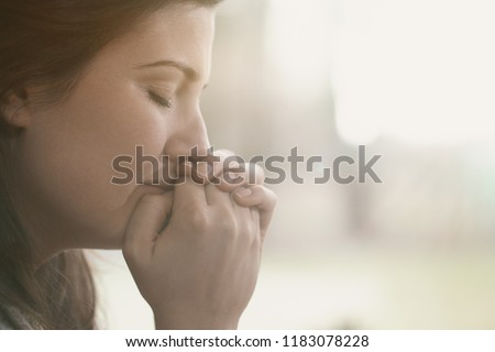 Lonely and depressed sad woman with hands on face #1183078228