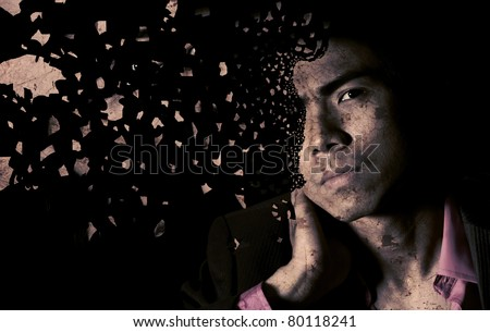Lonely Asian businessman with shatter face and sad expression in dark black background