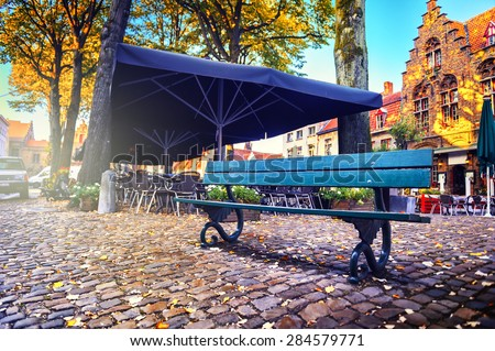 lonely bench and outdoor cafe...
