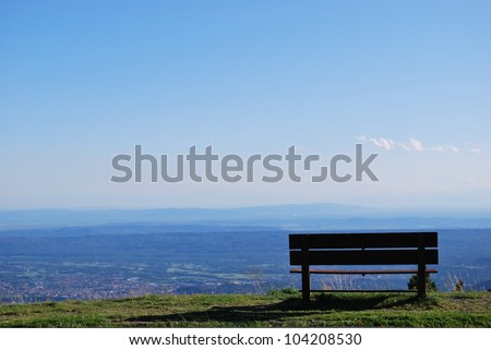 Lonely bench with breathtaking panoramic view on Po valley, Piedmont, Italy - stock photo