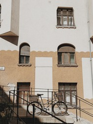 Lonely bicycle against vintage building. Adventure, journey, travel concept. Sunny day.