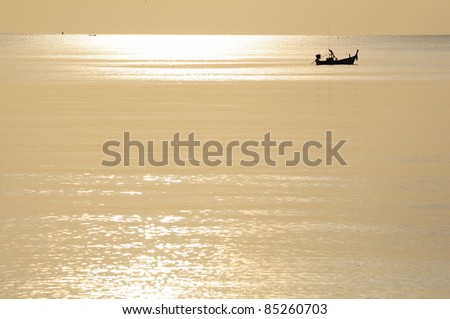 Lonely boat floating in sea on sunrise background