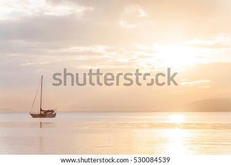 Lonely boat in a calm sea for background