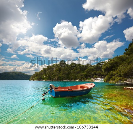 lonely boat in the bay in Mljet. Croatia.