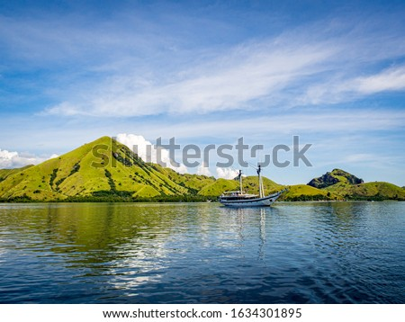 Lonely boat in the ocean with clear blue sky stock photo
