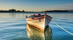Lonely boat in the pier of Eretria port in Greek island Evia