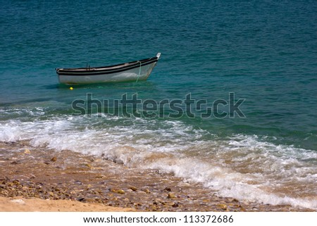 Lonely boat on a sea
