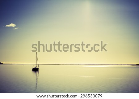lonely boat on calm sea