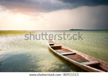 Lonely boat on lake. Composition of nature.