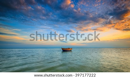 Lonely boat on the Baltic Sea at sunset. HDR - high dynamic range